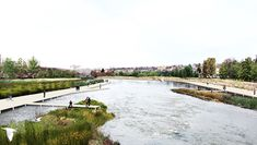 these paths redefine the existing urban connections by extending them to the water's edge, creating a visual and physical connection between the city fabric and the river.