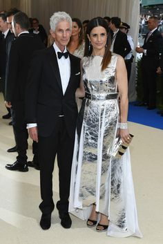 Richard Buckley and Livia Firth in Laura Strambi. Photo:Dia Dipasupil/Getty Images