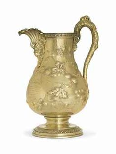 A SILVER-GILT WATER PITCHER  MARK OF NEWELL HARDING, BOSTON, CIRCA 1855  Baluster form, on gadrooned circular foot, the body chased with oak leaf and acorn decoration, the handle formed as a branch, engraved with presentation inscription, marked under base  13 3/8 in. (33.4 cm.) high; 60 oz. 10 dwt. (1,884 gr.)