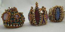 Finger Crowns - Taught by Nikia Angel at the Creative Castle in CA.   Spend a day creating this crown for your finger inspired by the wives of King Henry VIII. These beautiful rings are made with bead embroidery stitches using vintage and antique materials. Design in miniature and learn to finish a small complex shape over an armature (brass ring form).  (L-R) Catherine of Aragon, Anne Boleyn or Jane Seymour.