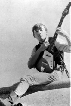 Bruce poses with his first electric guitar, a Japanese made Kent , which his mother Adele bought him for Christmas in 1964 for $60.