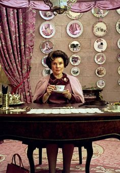 Professor Umbridge- screw Voldemort and Bellatrix, she is the villain I hate the most. I love Voldy and Bella. They're a fun evil that's great to read or see. I was listening to HP5 on audiobook, and I almost threw it at the wall when she took Harry, Fred and George's brooms away.