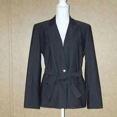 """Express Black Belted Stretch Trench Blazer Womens Size 11/12   Excellent Pre-owned Condition no stains or holes.   1 Button Front Closure  4 Pockets  Tye Belt  Fitted Linned   70% Cotton 28% Nylon 2% Spandex  Lining 100% Acetate     Aprox. Measurements Taken Flat   Shoulders: 17""""  Bust: 19""""  Sleeves:24/18""""  Length: 26""""   $15.99 + $6.80 Shipping   Combined shipping is $3.00 each additional item   Follow Me On FaceBook https://www.facebook.com/Sandra..."""