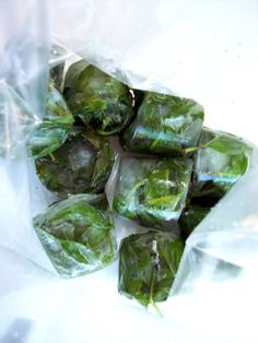"Freeze Basil   ""Pluck the whole leaves and set them in a small paper cup, fill with water until the herb is submerged, then freeze. When frozen solid, pop the block of ice with the embedded herbs out of the paper cup and into a ziplock bag. The herbs, once the ice melts will be fresh and ready to use."""