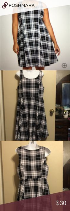 Torrid Textured Plaid Skater Dress Textured black & white Plaid print is swingy with pleated paneled seams. 96% polyester,4% spandex. Lining 100% polyester. Length is 371/2 inches. Underarm to underarm is 19 1/2 inches . Waist is 16 inches . Has some elastic in waist . This is a pull over the head . No zipper. torrid Dresses Midi