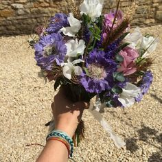 Back from a wonderful break spent with awesome family and friends, glorious sunshine and a beautiful wedding too! Couldn't resist the chance to show off my bridesmaid bouquet - I'm wearing custom waxed thread bracelets available in CraftyMotMot now :)