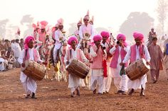 "Village musicians play ""Dhol "" (drum) during the tent pegging festival  - Punjab Pakistan"