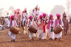 "Village musicians play ""Dhol "" (drum) during the tent pegging festival  - Punjab Pakistan"