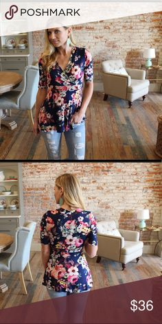 "Navy floral cross front short sleeve top Modeling size small.  95% rayon 5% spandex. Bust laying flat: S 15"" M 16"" L 17"" Length S 27"" M 28"" L 29"". Add to bundle to save when purchasing.  LA9030407 Tops"