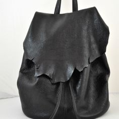 Beautiful handmade leather rucksack created by Pas Vu Lab