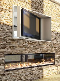 Love this double sided fireplaces with surrounding schist wall