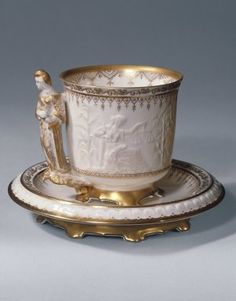 """Liberty"" Cup and Saucer  Manufacturer: Union Porcelain Works, 1863-ca.1922  Designer: Karl L. H. Mueller, American, born Germany, 1820-1887  Medium: Ceramic  Place Manufactured: Greenpoint (now Brooklyn), New York, USA  Dates: ca. 1876"
