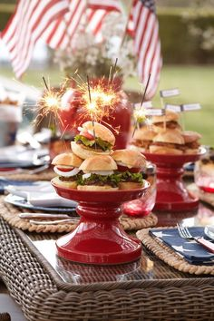 pretty 4th of July table setting and burger presentation with sparklers