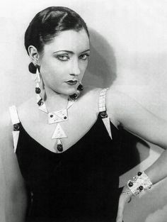 Gloria Swanson wearing deco jewelry