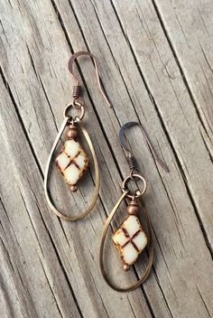 "Beige colored Czech glass ""argyle"" patterned beads with hammered, antiqued copper hoop and ear wire. These are fairly small earrings, approx 1.5"" in total length."