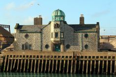 Old Customs House, South Pier, Dover Harbour, Kent, England, United Kingdom. Customs Watch House with green copper belvedere (observation dome, cupola) built between 1909 and 1911 by architect, Arthur Beresford Pite. Located South Pier with Inner Harbour to the left and Tidal Harbour of Dover Marina to the right. View from North Pier (old hoverport). Nearby in the Western Docks is Lord Warden House (ex-Lord Warden Hotel). UK Architecture and History. See: http://www.panoramio.com/photo/99318912