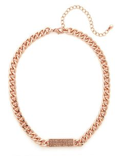 This beautiful necklace flaunts an utterly feminine yet street-chic sensibility. With those chunky chains and pavé bar pendant, its plenty refined, too.