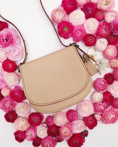 Peonies are pink and some bags too! #Coach #SS16 #BagOfTheDay