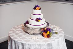 Floral decorated cake and toss bouquet