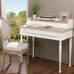 Boasting a white-streaked and distressed finish plus plenty of storage space via four drawers and a well-positioned shelf, our Anjou Traditional French Accent Writing Desk combines flair and utility.