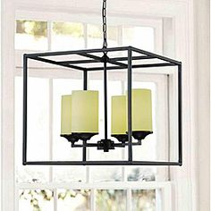 @Overstock - This modern black metal and glass chandelier adds a twist of contemporary chic to any decor. The stylish chandelier hangs from a thick black chain and features four beige glass shades encased in a black metallic, pillar construction chandelier.http://www.overstock.com/Home-Garden/Large-Black-4-light-Pillar-Chandelier/4103778/product.html?CID=214117 $130.99