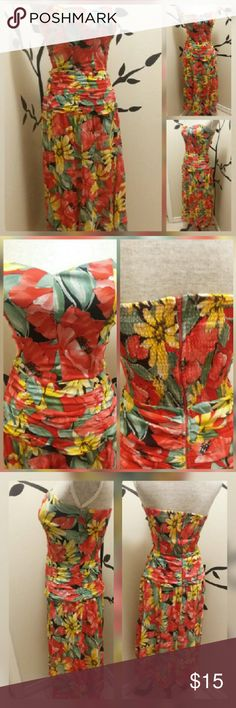 Secrets dress Beautiful floral dress. 100% acetate. Made in the USA. Stretchy elastic in back where zipper is located. Flowy sheer bottom. Secrets Dresses