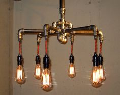 This steampunk chandelier by The Milton Douglas Lamp Co. is the perfect light fitting for a garage, man-room, shed, bar or basement laboratory.