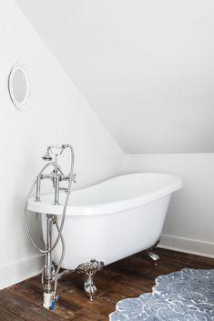 The soaking clawfoot tub is from Wayfair.