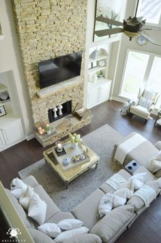 Two Story Living Room Great Room with Stacked Stone Fireplace to Ceiling and…