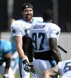 Carolina Panthers' new defensive end Jared Allen (69) talks with Mario Addison (97) while warming up during his first day of practice with the team on Wednesday, September 30, 2015. Allen was acquired from the Chicago Bears on Monday.
