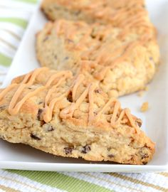 Easy and delicious Chocolate Chip Peanut Butter Scones with peanut butter glaze. A must try scone recipe.