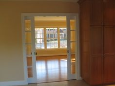 I would love to replace the french doors between the family room and playroom with glass pocket doors.