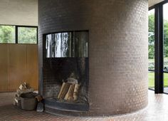 Circular fireplace / hidden bathroom in The Glass House by Philip Johnson |  Remodelista