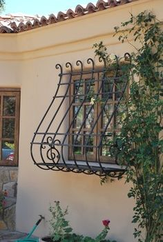 Clever, though I don't plan on living anywhere where I need bars on my windows.Window Guard with Planter Box - traditional - exterior - phoenix - Grizzly Iron, Inc Iron Windows, Window Decor, Traditional Exterior, Iron Window Grill, Wrought Iron Window Boxes, Spanish Style Homes, Iron Decor, Exterior, Wrought Iron Wall Decor