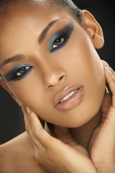 Beautiful blue shimmer eye shadow, and undereye soft black around gorgeous colour eyes. Pretty natural blush and light brown lips.