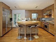 Ultra-luxe modern kitchen with natural wood. #design #decor #contemporary