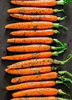 Garlic and Herb Roasted Carrots - these carrots are roasted to perfection with lots of garlic and herbs such as thyme, basil and oregano, creating the perfect side dish. Roasted Carrots, Roasted Vegetables, Veggies, Roasted Mushrooms, Carrot Recipes, Vegetable Recipes, Easter Recipes, Jo Cooks, Asparagus Soup