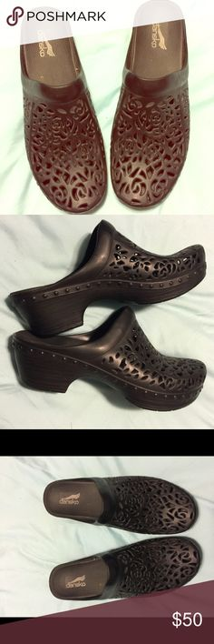Dansko Avalon Pippa Clog This women's clog is set in a durable thermoplastic compound upper and features abstract floral cutouts. Gently worn a few times. Like new. Dansko Shoes Mules & Clogs