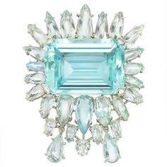 Aquamarine Clip-Brooch   Platinum, centering one emerald-cut aquamarine approximately 47.00 cts., framed by 25 pear-shaped aquamarines, supporting 2 flexibly-set pear-shaped aquamarines,
