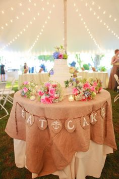 Wedding cake table deco - could do brights instead of burlap & check out the lights in the tent
