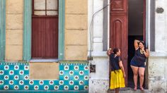 Cuba women — A mother and her daughter talk on a street in Havana.