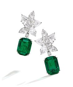 Get a sneak peek at the one-of-a-kind pieces—from a sapphire-encrusted brooch to glittering diamond-set clusters—at Sotheby's Important Jewels Auction this September 24th and 25th. Pictured: Pair of Platinum, Emerald and Diamond Pendant-Earclips, Harry Winston with Colombian emeralds weighing 12.16 and 10.18 carats.