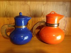 These are often confused as California pottery carafes.  The aren't carafes at all but rather batter pitchers for pouring pancake or waffle batter.  The one on left is Red Wing and the other is made by Rumrill both from Ohio.
