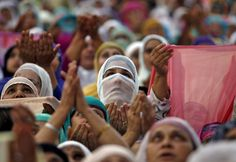 Kashmiri Muslim women pray upon seeing a relic, believed to be a hair from the beard of the Prophet Mohammad, displayed to devotees on the death anniversary of Hazrat Ali at Hazratbal shrine during the holy month of Ramadan in Srinagar July 9, 2015. Hundreds of Kashmiri Muslims on Thursday thronged to the Hazratbal shrine which houses what is believed to be a relic from the beard of Prophet Mohammed to offer prayers on the occasion of death anniversary of Hazrat Ali, son-in-law of Prophet…