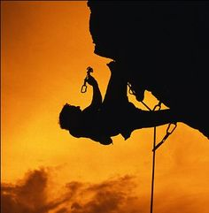 Trad climber silhouette, on belay, placing protective gear. #climbchat