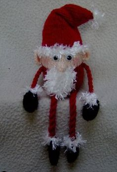 No Christmas celebration is complete without an appearance of a santa or two.  Use knit Christmas tree ornament patterns like this to your advantage and decorate the entire house.  This Dangly Leg Santa is simple to put together and great for anyone who is interested in making festive decor.