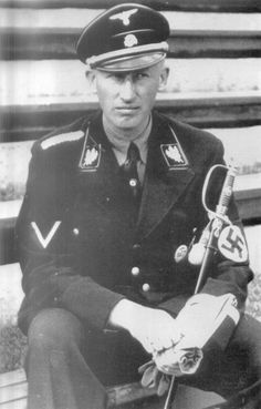 Reinhard Heydrich as a high-ranking German Nazi official during World War II, and one of the main architects of the Holocaust.