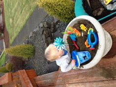 Small Sandbox on the deck. Used old planter, new sandbox sand, and toy. Even has buried surprises!! Perfect for toddlers.