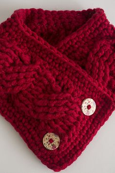 Chunky, thick and cozy, the Cherry Tart Cowl will surround your neck with plush fibers and protect you from the bitter cold. The cable stitches create luxurious texture and the vintage floral buttons give it a feminine touch.