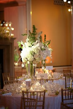 Tall white wedding centerpieces.  www.mikiandsonja.com